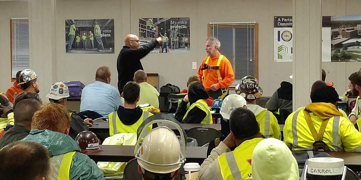 Jobsite safety meeting with trades