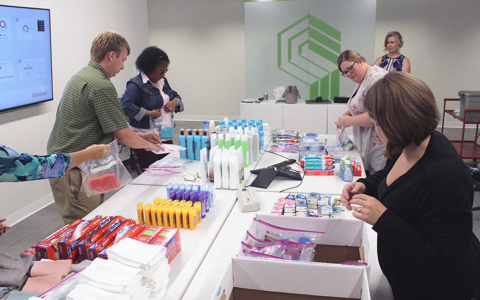 Packing personal care kits for United Way